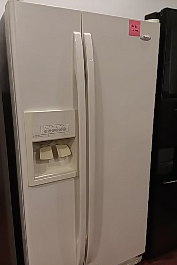 Whirlpool side by side refrigerator excellent condition  1af429cc-71f2-4f98-aa70-50096e7d0b3d