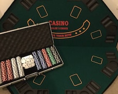 black and green Poker chips set and poker table