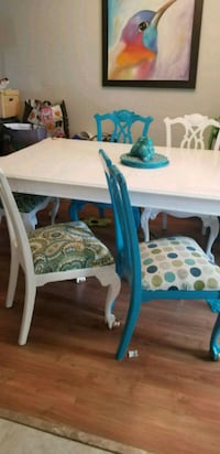 Large solid mahogany table,2 leafs, 8 chairs  Kelowna, V1Y 3P9