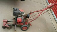 red and black push mower Lubbock, 79412