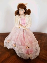 Vintage doll with stand.$12