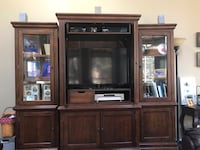 Flat screen television; brown wooden tv hutch Herndon, 20171