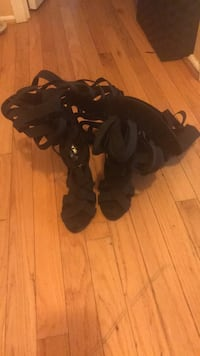 pair of black leather gladiator sandals
