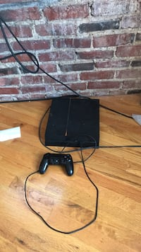 black Sony PS4 console with controller Boston, 02120