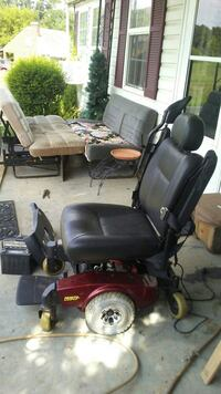 black and red motorized wheelchair null