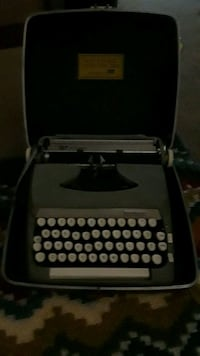 black and gray typewriter with case Cookeville, 38506