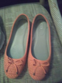 pair of beige leather flat shoes