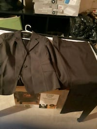 Dark gray formal suit jacket with matching pants . Whitby, L1N 9E2