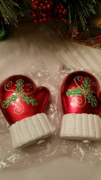 pair of red-and-white ceramic gloves decorations