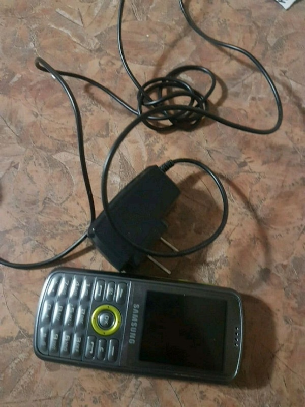 black and gray Nokia candy bar phone 0