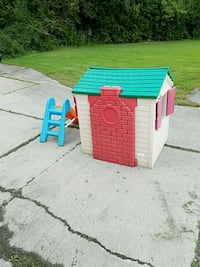 white, blue, and red plastic playhouse Cohoes