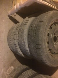 Gray bullet hole car wheel with tire michelin