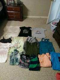 Size medium shirts sweaters and dresses