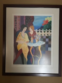 two woman sitting on chair near table painting with black frame CALGARY