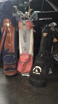 two black and one red golf bags 624 mi
