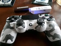 white and black Sony PS4 controller Shearwater, B0J 3A0