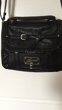 Black leather guess crossbody bag/tiny lipstick stain inside but great condition