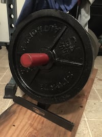 Pair of 45 pound Olympic Weight plates. Bench. Gym. Fitness.