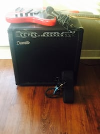 danville black guitar amplifier and red electric guitar with microphone