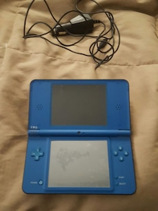 blue handheld game console Nintendo ds xl
