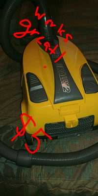 yellow and black Eureka Rally2 vacuum cleaner Jarvis, N0A 1J0