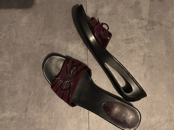 Calvin Klein special limited edition unique and rare gorgeous slip on sandals. Size 10, wine color.  Bought at Nordstrom for $140 US, worn only twice, excellent condition