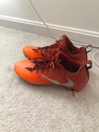 pair of orange Nike cleats Sterling, 20165