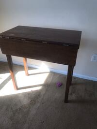 Brown wooden single table