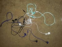 five white, blue, black, and green earbuds