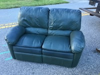 Leather dual reclining loveseat  South Daytona, 32119