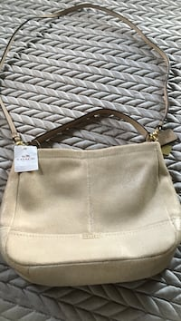 Gold Authentic  Coach purse new tags attached