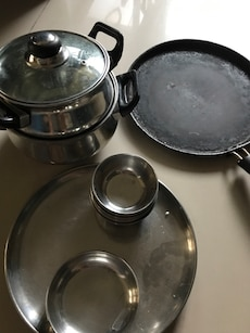Steel plates 4, small sabzi plate 4, small catories 16 , cooking pots 2 and one tawa