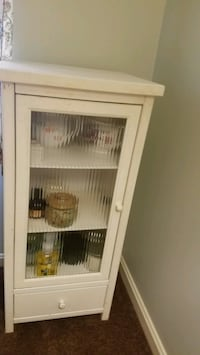 White cabinet with 3 shelves,  1 drawer