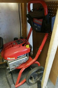 red and black Troy-Bilt gas chainsaw 50 km
