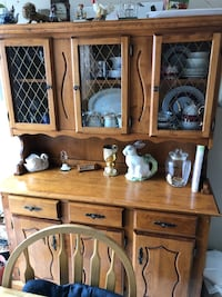 Brown solid wood buffet hutch in vey good condition price reduction. Need space