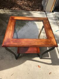 square brown wooden framed glass top coffee table Tampa, 33612