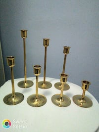 seven brass-colored candle holders