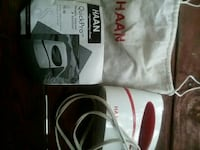 white and red HAAN QuickPro portable steamer & sanitizer with box
