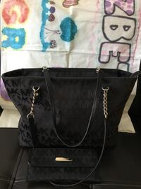 Authentic Black Michael Kors tote bag and wallet Price is non negotiable !
