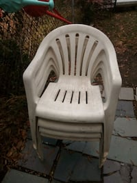 Four Plastic Patio Chairs