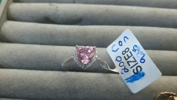 heart-shaped embellished pink gemstone silver-colored ring