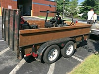brown and black utility trailer 31 km