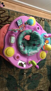 baby's pink and green activity saucer Union