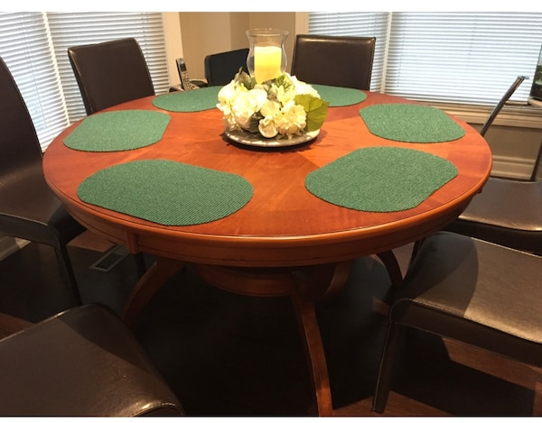Solid brown wooden round table only