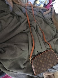 Black and brown louis vuitton leather wristlet fake San Diego, 92114