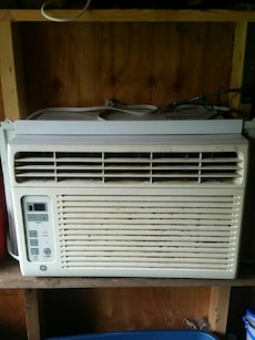 white General Electric window type air conditioner