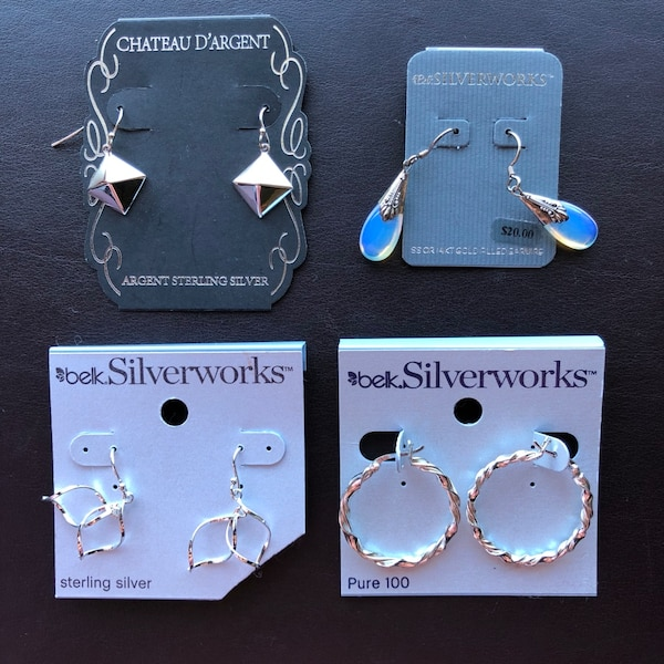 Assorted silver pairs of earrings. some sterling silver
