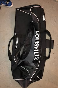 Black Louisville Slugger wheel'd catchers bag/ equipment bag.