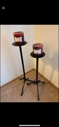 Cast iron candlesticks with candles