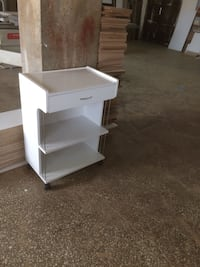 white wooden 3 layer end table